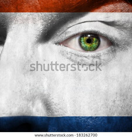 Crimea flag painted on a man's face to show support for Crimea - stock photo