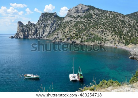 Crimea. Novy Svet. Mountain Karaul-Oba and small boats in the blue Bay