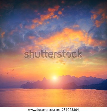Crimea sunset above the sea with beautiful reflection of sun light on a water - stock photo