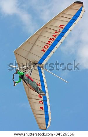 CRIMEA, UKRAINE - SEPTEMBER 7: Competitor h of the Grininko hang gliding competitions takes part on the Klementieva mountain on September 7, 2011 in Crimea, Ukraine - stock photo