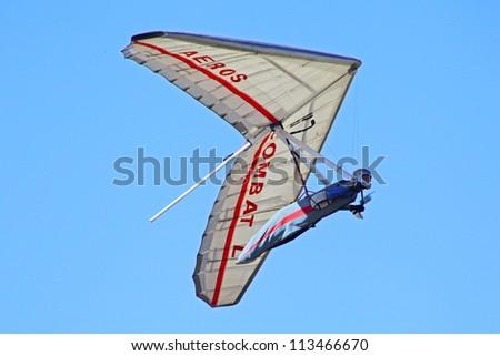 CRIMEA, UKRAINE - SEPTEMBER 4: Competitor  of the Grininko hang gliding competitions takes part in the Klementieva mountain on September 4, 2012 in Crimea, Ukraine - stock photo