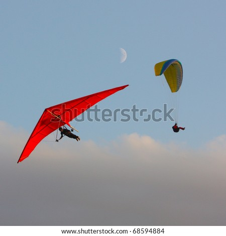 CRIMEA, UKRAINE - SEPTEMBER 9: Competitor  of the paragliding competitions takes part on the Klementieva mountain on September 9, 2010 in Crimea, Ukraine