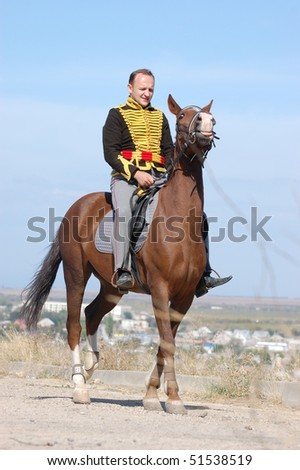CRIMEA, UKRAINE - SEPTEMBER 26: Member of military history club ALMA wears Russian historical uniform during historical reenactment of Crimean War September 26, 2009 in Crimea, Ukraine