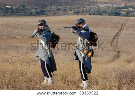 CRIMEA, UKRAINE - SEPTEMBER 26 : Members of military history club wear Russian historical uniforms during historical reenactment Crimean War near Alma river on September 26, 2009 in Crimea, Ukraine