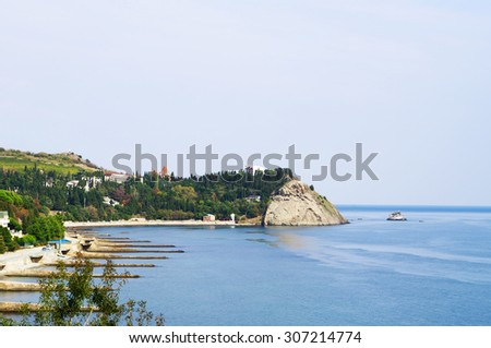 Crimean Black seascape, view of rocky cape Plaka and Aivazovsky park beach coastline - stock photo