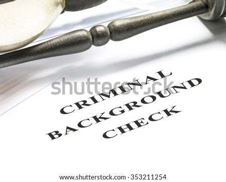 Criminal background check application form with hourglass on background. - stock photo