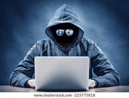 criminal on a computer - stock photo