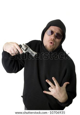 Criminal or Gangster with revolver and dark glasses - stock photo