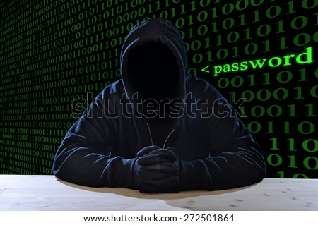 criminal or terrorist man in gloves, black hood and thief mask looking dangerous with hidden identity in secret illegal password violation and crime concept with creepy scary terrorist and maniac look - stock photo