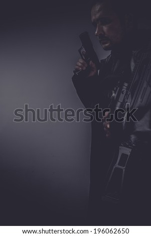 Criminal, portrait of murderer with gun - stock photo