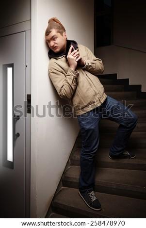 Criminal - victim in elevator - stock photo