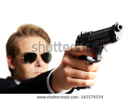 criminal with a gun on white background