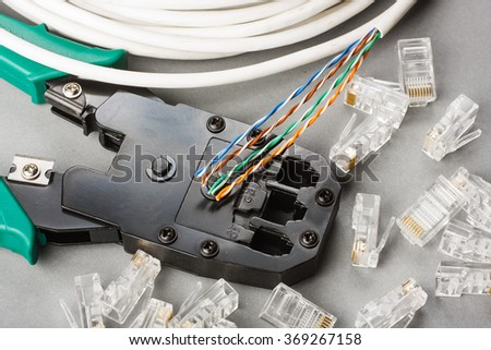 Crimper, network cable and connectors - stock photo
