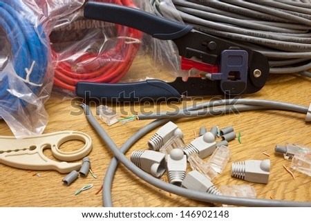 Crimping network cable - stock photo