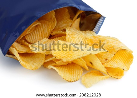 Crinkle cut crisps spilling out of a foil packet. - stock photo