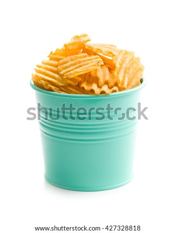 Crinkle cut potato chips isolated on white background. Tasty spicy potato chips. - stock photo