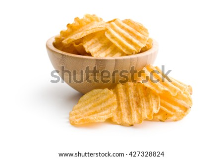 Crinkle cut potato chips isolated on white background. Tasty spicy potato chips in bowl. - stock photo
