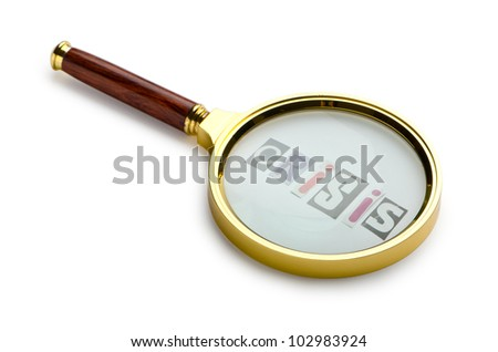 Crisis concept with magnifying glass - stock photo