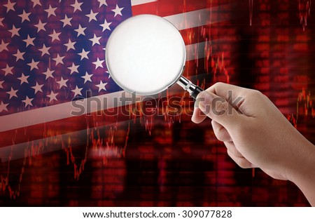 Crisis in USA - Shares Fall Graph on United States of America Flag with hand holding magnifying glass analyze solution ideas concept design - stock photo