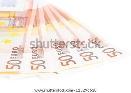 crisis of eurozone, detail of some 50-euro banknotes on white background - stock photo