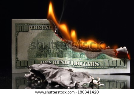 Crisis. One hundred dollars in fire, burning dollar, ashes - stock photo