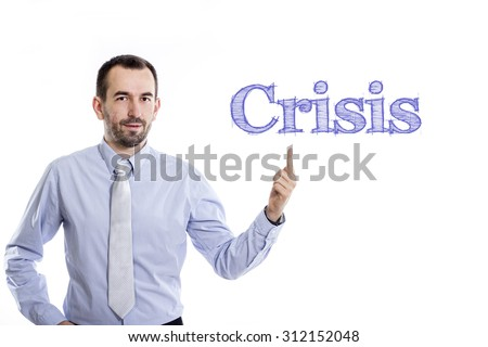 Crisis - Young businessman with small beard pointing up in blue shirt - stock photo