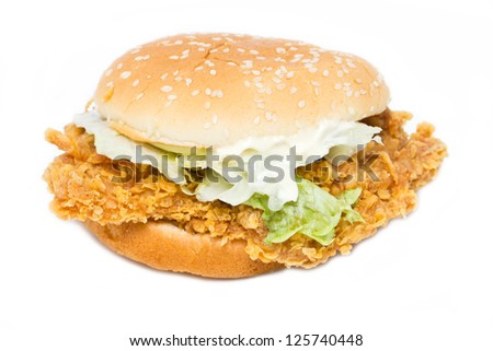 Crisp chicken burger with lettuce isolated on white. - stock photo