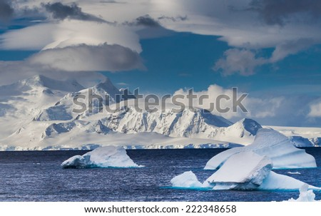 Crisp, clean snow covers mountains near Niko Bay in Antarctica - stock photo