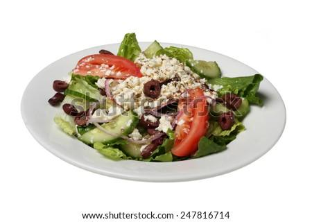 crisp fresh greek salad isolated on white - stock photo