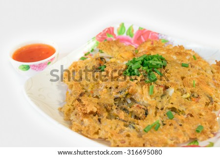 Crisp fried mussel pancakes. Shell fried with vegetables and spicy sauce (Hoi Tod) - stock photo