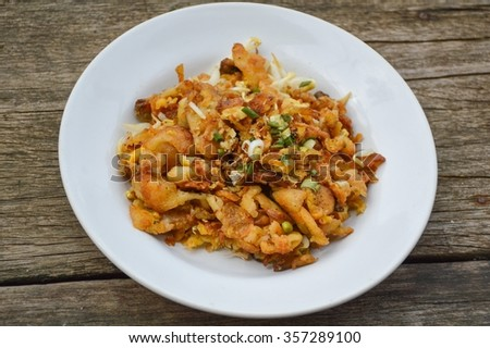 Crisp fried mussel pancakes. Shell fried with vegetables (Hoi Tod) - stock photo