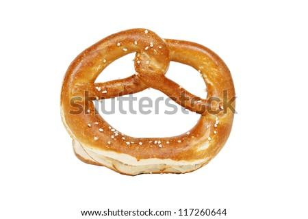 Crisp golden pretzel on white background - stock photo