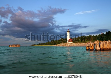 Crisp Point Lighthouse. Image of the Crisp Point Lighthouse at sunset. - stock photo