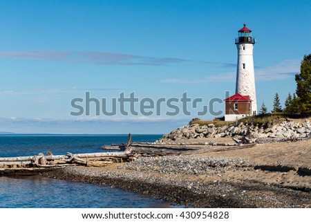 Crisp Point Lighthouse towers above Lake Superior in the Upper Peninsula of Michigan - stock photo