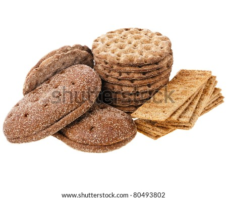 crispbread and rye bread heap close up isolated on white background - stock photo