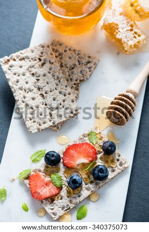 Crispbread with honey and berries for tasty breakfast