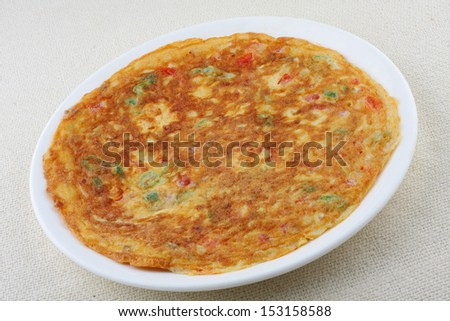 Crispy and spicy omelet. - stock photo