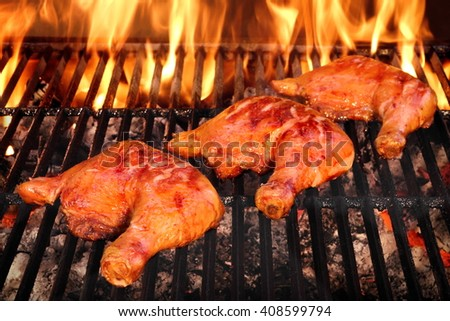 Crispy And Tasty BBQ Chicken  Quarters Roasted On The Hot Charcoal Flaming Grill, Closeup, Top View - stock photo
