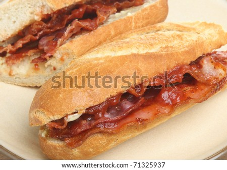 Crispy bacon baguette with tomato ketchup.
