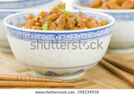 Crispy Beef - Oriental battered and deep-fried beef with sweet chilli sauce. - stock photo
