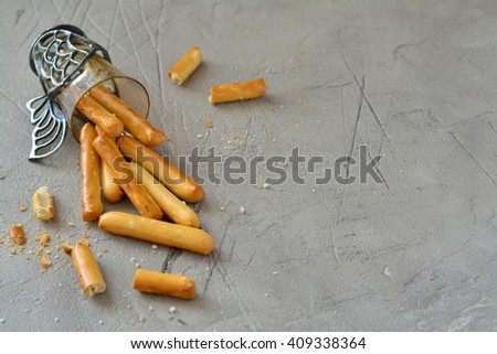 Crispy bread sticks on a gray background with empty space - stock photo