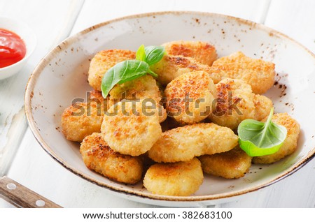 Crispy chicken nuggets with sauce. Selective focus - stock photo