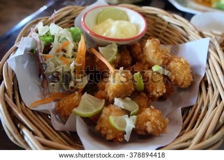 Crispy chicken with lemon sauce on basket  - stock photo