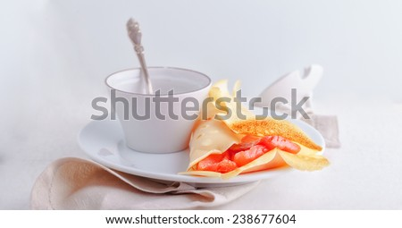 Crispy crepes with smoked salmon  and  cream cheese. Gluten free. Flour from rice. - stock photo