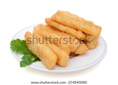 crispy fish sticks with cilantro on plate on white background - stock photo