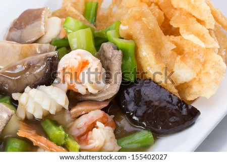 Crispy fried noodle with seafood toppings