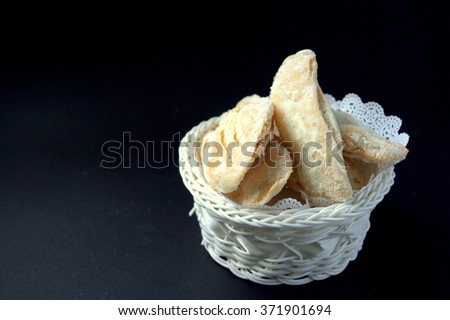crispy fried pastry dusted with milk. Famous snack in Sabah Malaysia. 'Kuih Lidah' in local languages.
