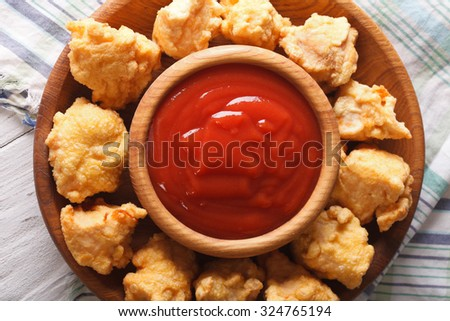 Crispy Popcorn Chicken and sauce close-up on a plate. horizontal view from above - stock photo