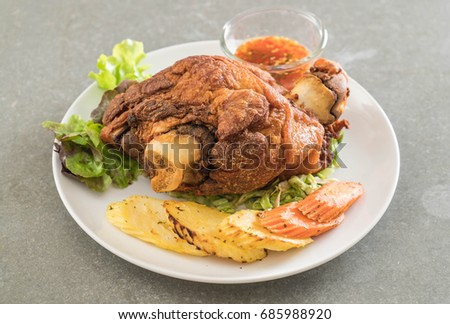 Crispy pork knuckle or German Pork Hocks on white plate