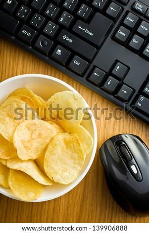 crispy potato chips on office table - stock photo